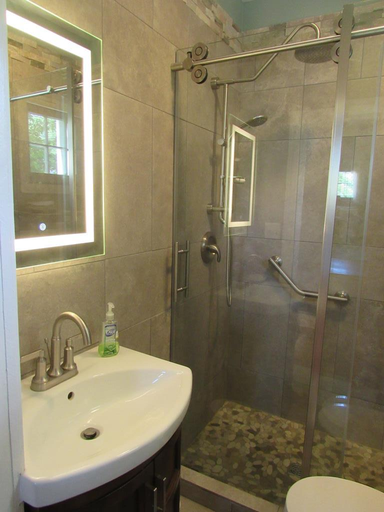 Bathroom with lighted LED mirror